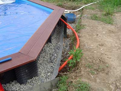 Piscine bois semi enterr e conseil astuces montage for Installation piscine enterree